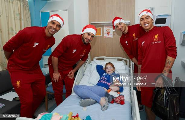 Liverpool players Joel Matip Emre Can Marko Grujic and Roberto Firmino making their annual visit to Alder Hey Children's Hospital on December 11 2017...
