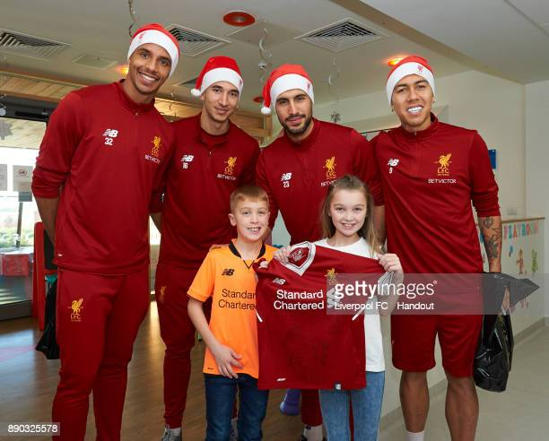 Liverpool players Joel Matip Marko Grujic Emre Can and Roberto Firmino making their annual visit to Alder Hey Children's Hospital on December 11 2017...