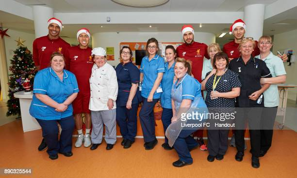 Liverpool players Joel Matip Roberto Firmino Emre Can and Marko Grujic pose with hospital staff while making their annual visit to Alder Hey...