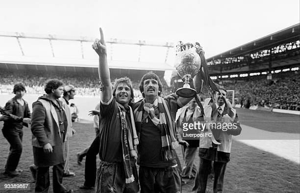Liverpool players Kenny Dalglish and David Johnson hold the Football League Division One trophy after the Football League Division One match between...