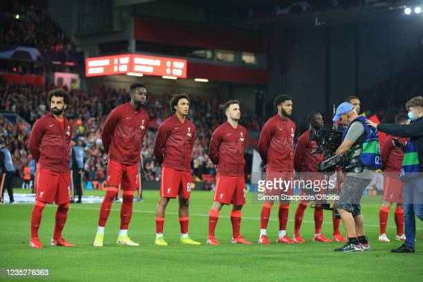 Liverpool players line up before the UEFA Champions League group B match between Liverpool FC and AC Milan at Anfield on September 15, 2021 in...