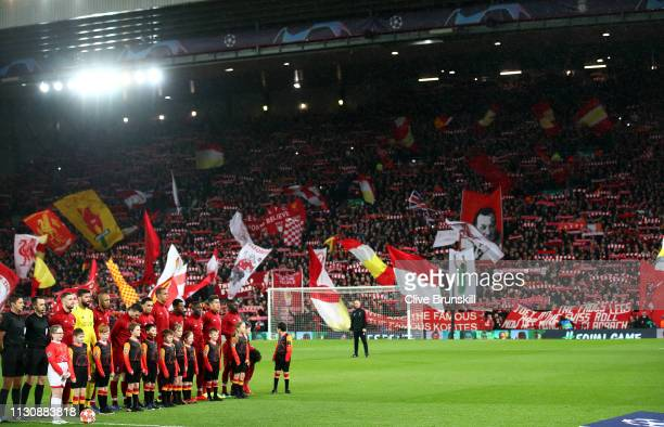 Liverpool players line up in front of the Kop prior to the UEFA Champions League Round of 16 First Leg match between Liverpool and FC Bayern Muenchen...