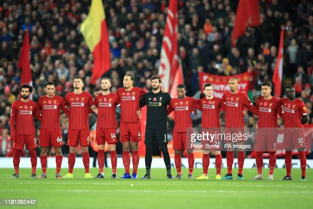 Liverpool players line up prior to kickoff during the Premier League match at Anfield Liverpool