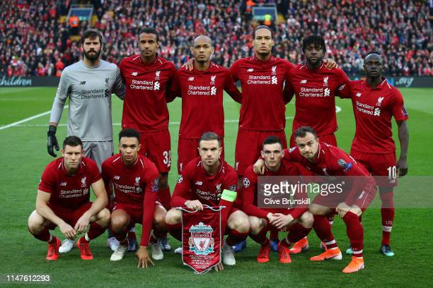 Liverpool players line up prior to the UEFA Champions League Semi Final second leg match between Liverpool and Barcelona at Anfield on May 07 2019 in...
