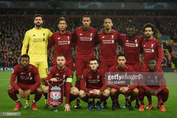 Liverpool players Liverpool's Brazilian goalkeeper Alisson Becker Liverpool's Brazilian midfielder Roberto Firmino Liverpool's Germanborn Cameroonian...