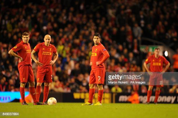 Liverpool players look dejected after the final whistle