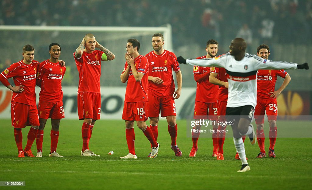 Liverpool players look dejected as Demba Ba of Besiktas (9) celebrates as Dejan Lovren of Liverpool misses the decisive kick in the penalty shoot out during the UEFA Europa League Round of 32 second leg match between Besiktas JK and Liverpool FC on February 26, 2015 in Istanbul, Turkey.