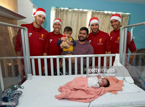 Liverpool players Marko Grujic Roberto Firmino Emre Can and Joel Matip making their annual visit to Alder Hey Children's Hospital on December 11 2017...