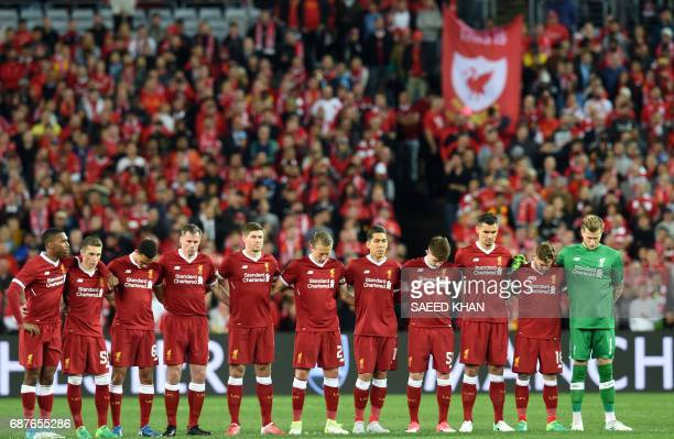 Liverpool players observe a minute's silence for victims of the Manchester terror attack during their endofseason friendly football match against...