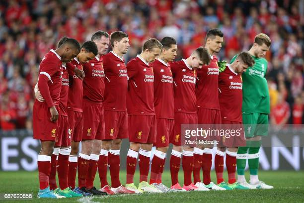 Liverpool players observe a minute's silence in memory of the victims of last night's terror attack in Manchester before the the International...