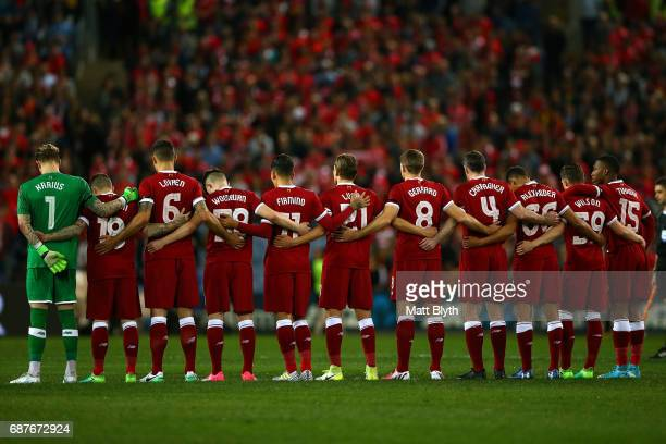 Liverpool players observe a minute's silence in memory of the victims of last night's terror attack in Manchester before the International Friendly...