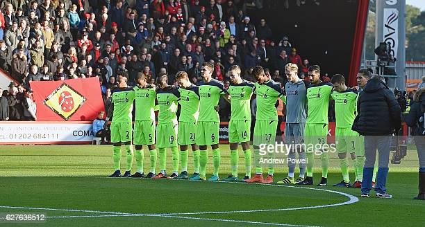 Liverpool players pause during a minute's silence for the victims of the Chapecoense plane crash before the Premier League match between AFC...