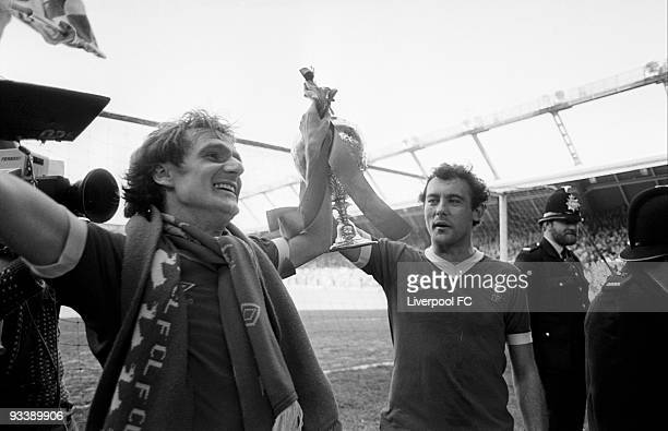 Liverpool players Phil Thompson and Ray Kennedy hold the Football League Division One trophy after the Football League Division One match between...