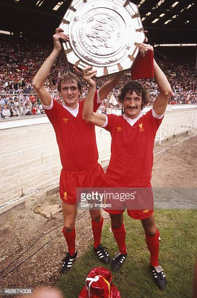 Liverpool players Phil Thompson and Terry McDermott hold the FA Charity Shield aloft after a 10 win over West Ham at Wembley Stadium on August 9 1980...