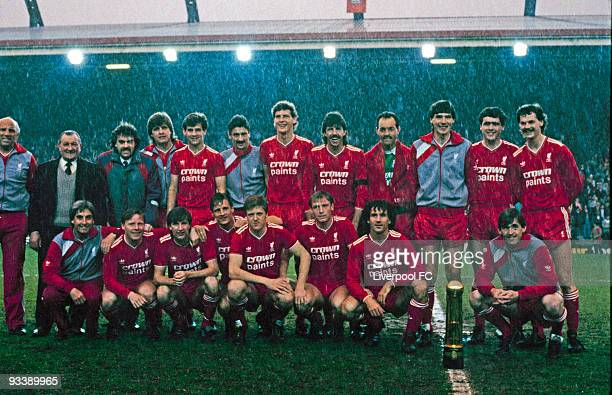 Liverpool players pose with the Canon League Division One trophy before the Screen Sport Super Cup SemiFinal Second Leg match between Liverpool and...