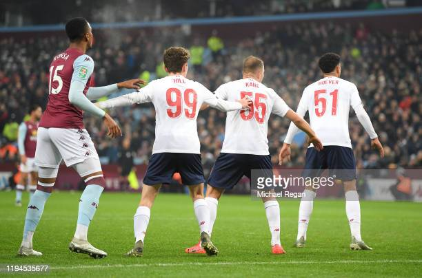 Liverpool players prepare to defend a set piece during the Carabao Cup Quarter Final match between Aston Villa and Liverpool FC at Villa Park on...