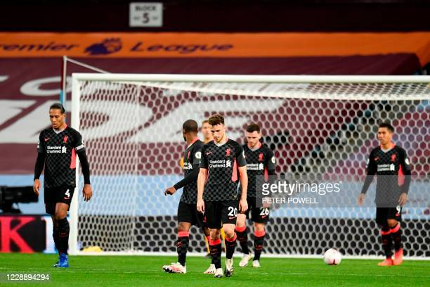 Liverpool players react to conceding their fourth goal during the English Premier League football match between Aston Villa and Liverpool at Villa...