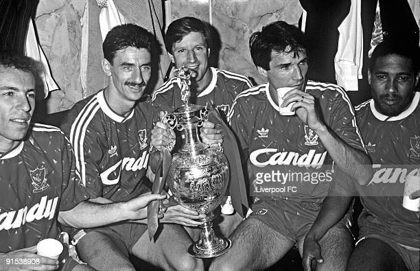 Liverpool players Ronnie Rosenthal, Ian Rush, Ronnie Whelan, captain Alan Hansen and John Barnes celebrate winning the league title with the trophy...