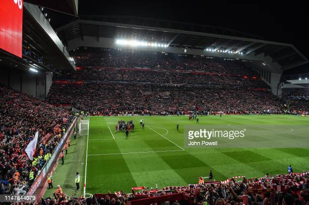 Liverpool players sing the anthem 'You'll Never Walk Alone with the Liverpool fans at the end of the UEFA Champions League Semi Final second leg...
