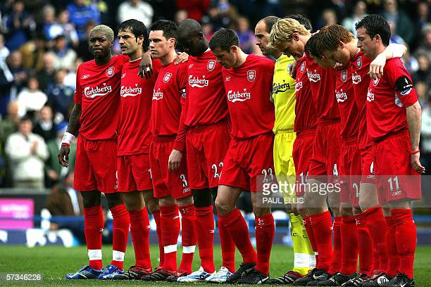 Liverpool players stand for a minute of silence before their English Premiership soccer match against Blackburn Rovers at Ewood Park Blackburn...