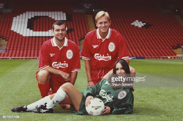 Liverpool players Steve Harkness and John Scales join model Kathy Lloyd as they pose in the new Liverpool home kit at the launch of the 1996/97...
