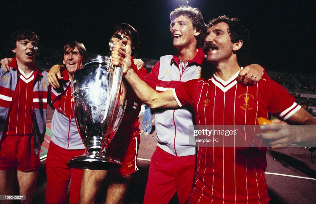 Liverpool players Steve Nicol, Kenny Dalglish, Alan Hansen (obscured), Gary Gillespie, and captain Greaeme Souness celebrate with the trophy after winning the UEFA European Cup Final between AS Roma and Liverpool FC held on May 30, 1984 at the Stadio Olimpico in Rome, Italy. The match ended in a 1-1 after extra-time, with Liverpool winning the match and trophy 4-2 on Penalties.