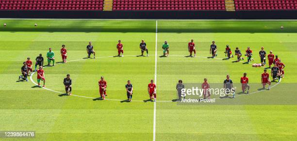 Liverpool players take a knee in memory of George Floyd at Anfield on June 01, 2020 in Liverpool, England.