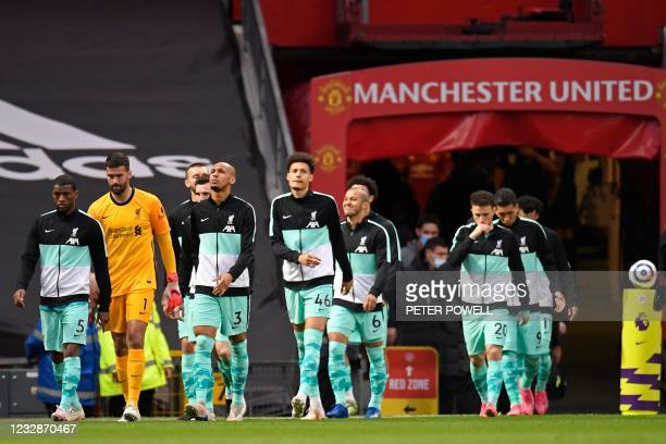Liverpool players walk out for the English Premier League football match between Manchester United and Liverpool at Old Trafford in Manchester, north...
