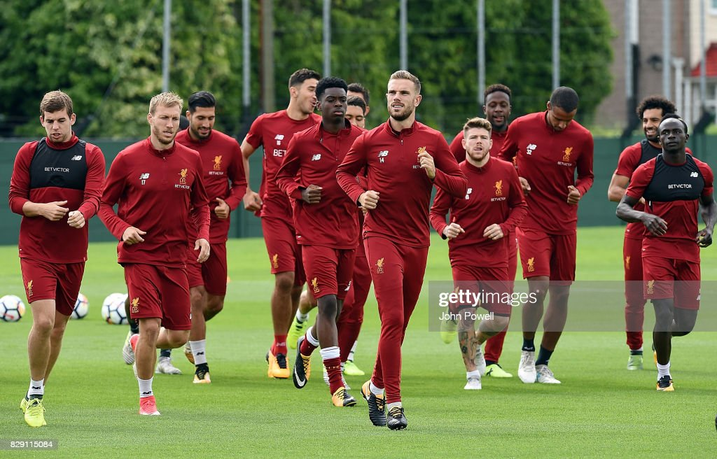 Liverpool players warm up during a training session at Melwood Training Ground on August 10, 2017 in Liverpool, England.