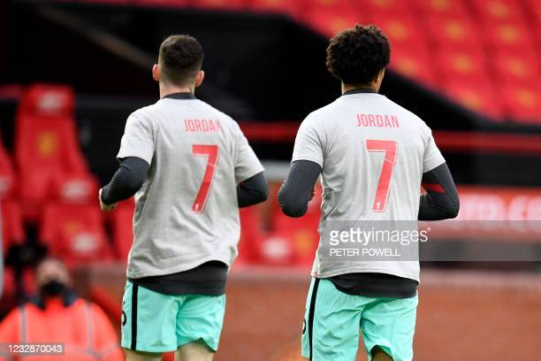Liverpool players warm up wearing shirts with a dedication to Jordan Banks, a boy who was killed by a lightening strike playing football this week,...