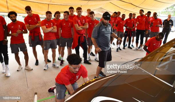 Liverpool players watch as Curtis Jones of Liverpool changes tyres during a tour of Roush Fenway Racing on July 21 2018 in Charlotte North Carolina