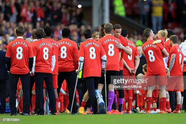 Liverpool players wear Steven Gerrard shirts after the Barclays Premier League match between Liverpool and Crystal Palace at Anfield on May 16 2015...