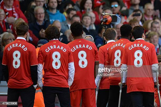 Liverpool players wear the number 8 shirt of their English midfielder Steven Gerrard in Gerrard's honour as they wait for him to return to the pitch...