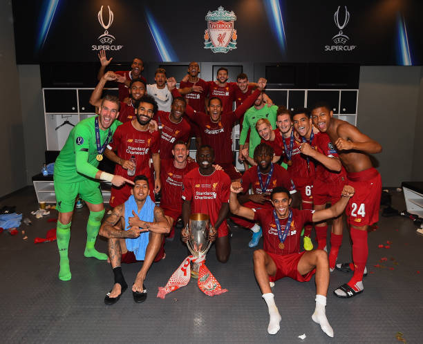 SUPER COUPE EUROPE UEFA 2019 Liverpool-players-with-the-uefa-super-cup-trophy-in-the-dressing-room-picture-id1168072938?k=6&m=1168072938&s=612x612&w=0&h=cAM8ZbJQQ0t3aG5cuJKRyeZYJc5zHb8bpO3m0aop3IA=