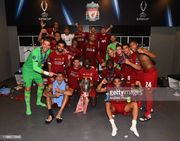 Liverpool players with the UEFA Super Cup trophy in the dressing room at the end of the UEFA Super Cup match between Liverpool and Chelsea at...