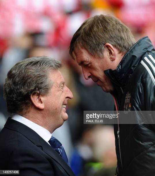 Liverpool 's Scottish manager Kenny Dalglish and West Bromwich Albion's English manager Roy Hodgson speak before the English Premier League football...