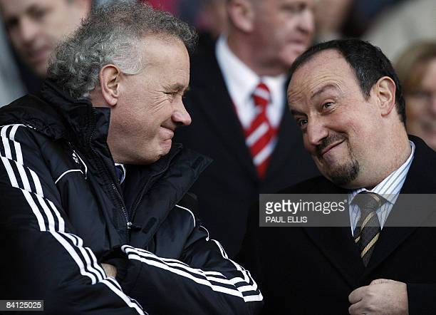 Liverpool 's Spanish manager Rafael Benítez joins club Chief Executive Rick Parry in the directors box before taking on Bolton Wanderers in their...