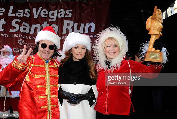 Liverpool Santa Dash organizer Alan Rothwell singer and grand marshal Shania Twain and Opportunity Village Associate Executive Director Linda Smith...
