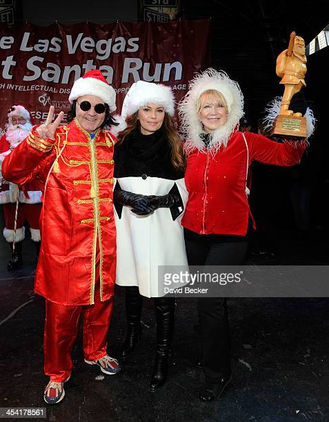 Liverpool Santa Dash orginizer Alan Rothwell singer and grand marshal Shania Twain and Opportunity Village Associate Executive Director Linda Smith...