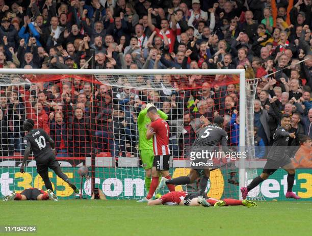 Liverpool score the only goal of the match at the English Premier League Match between Sheffield United and Liverpool at the Bramall Lane Ground...