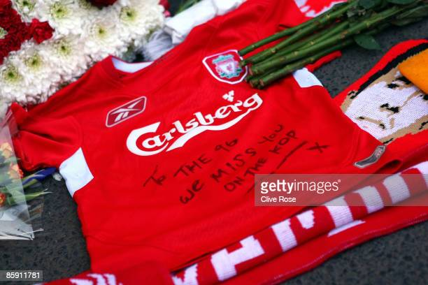 Liverpool shirt is laid in tribute at the Liverpool memorial for those who died in the Hillsborough disaster prior to the Barclays Premier League...