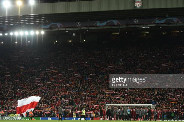 Liverpool squad and backroom staff celebrate in front of the Kop after winning the UEFA Champions league semifinal second leg football match between...