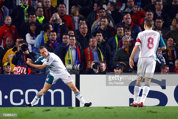 Liverpool striker Craig Bellamy celebrates with his 'Golf Swing' after scoring during the UEFA Champions league Round of 16 1st leg match between...