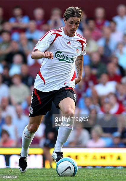 Liverpool striker Fernando Torres runs with the ball during the Barclays Premier League Match between Aston Villa and Liverpool at Villa Park on...