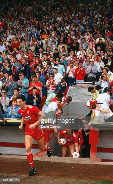 Liverpool striker Ian Rush enters the field before a League Division One match between Liverpool and Everton at Anfield on April 25 1987 in Liverpool...