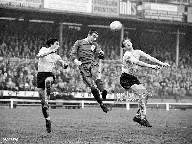 Liverpool striker Ian St John beats two Watford defenders to head the ball towards the goal during their FA Cup 3rd round match at Vicarage Road in...