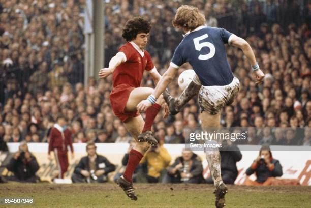 Liverpool striker Kevin Keegan challenges Ken McNaught of Everton during the FA Cup semi final which finished 22 at Maine Road Manchester on April 23...