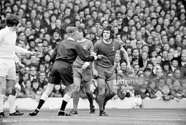 Liverpool striker Kevin Keegan is restrained by the referee after he had been tackled by Leeds United defender Norman Hunter during their First...