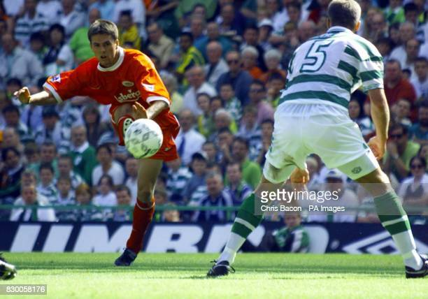 FEATURE Liverpool striker Michael Owen tries to put the ball past Celtic's defender Marc Rieper during the friendly match to mark the opening of the...