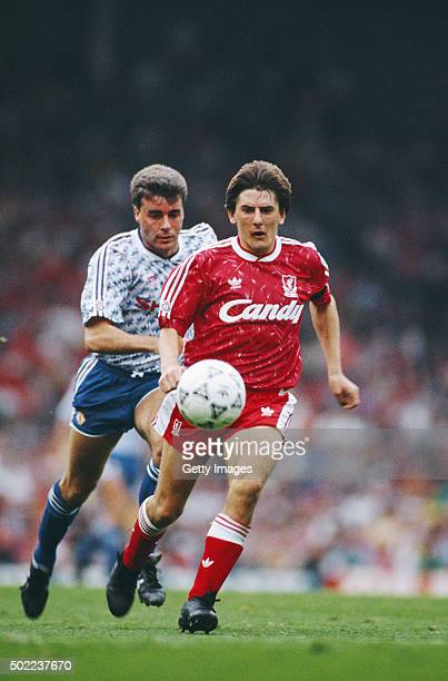Liverpool striker Peter Beardsley outpaces Manchester United defender Mal Donaghy on his way to scoring his third and Liverpool's fourth goal during...